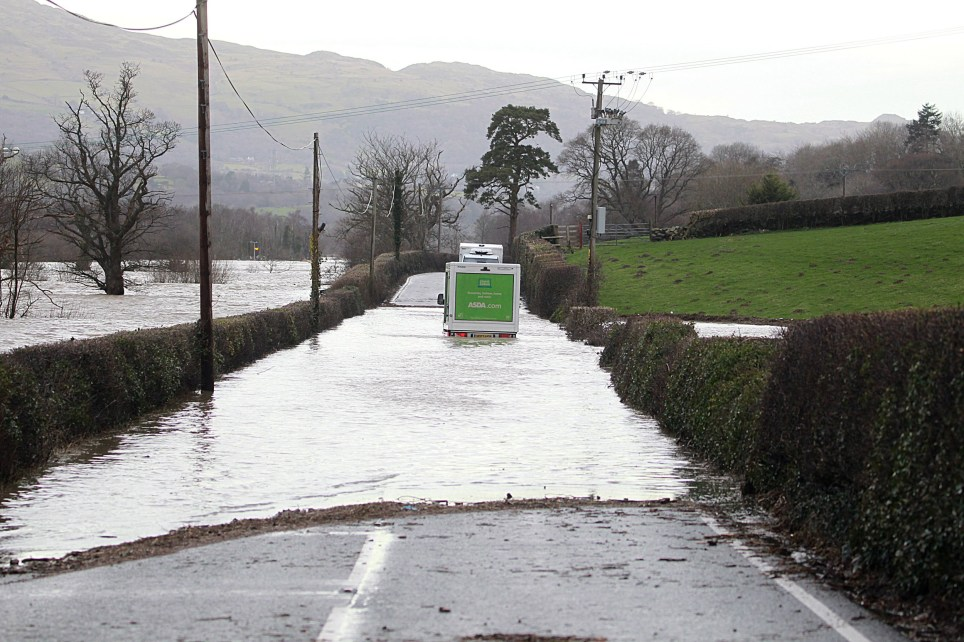 Feb 9 2020 The A470 in North Wales closed flowing flood water from the River Conwy in the wake of Storm Ciara. Pictured: An ASDA delivery van is stuck in the water. Photo by Ian Cooper/North Wales Live