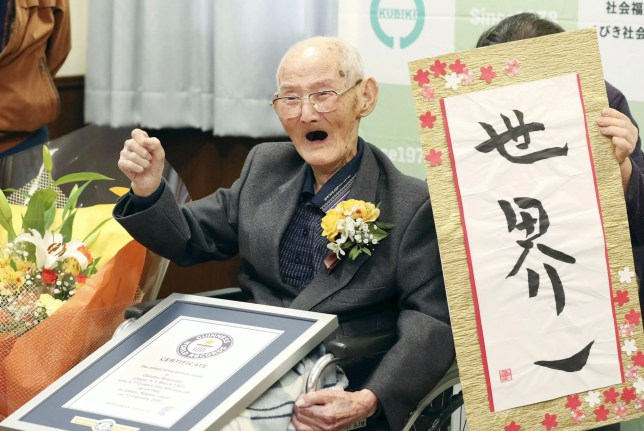 112-year-old Chitetsu Watanabe poses next to the calligraphy reading 'World's Number One' after being awarded as the world's oldest living male by Guinness World Records, in Joetsu, Niigata prefecture, northern Japan February 12, 2020, in this photo released by Kyodo. Mandatory credit Kyodo/via REUTERS ATTENTION EDITORS - THIS IMAGE WAS PROVIDED BY A THIRD PARTY. MANDATORY CREDIT. JAPAN OUT.