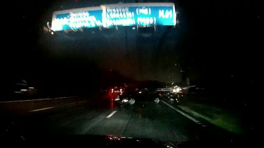 "Video grab from dashcam footage showing the shocking moment BMW driver David Lingard, 53, crashed into an abandoned car that ""appeared out of nowhere"" and on the M61 in Lancashire last year. See SWNS story SWLEdashcam. This shocking dashcam footage shows the moment a motorist crashed into abandoned car that ""appeared out of nowhere"" and on an unlit motorway. BMW driver David Lingard, 53, says he thought he was ""going to die"" the split second before the 65mph smash on the M61 in Lancashire last year. In the shocking dashcam clip the dad-of-four can be seen moving into the far right lane to avoid two braking vehicles as torrential rain pours down. All of a sudden, with just seconds to spare, an abandoned car comes into shot - leaving Mr Lingard no other option but to plough straight into it at 65mph."