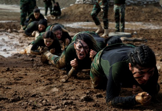 Members of Kurdish Peshmerga Special Forces demonstrate their skills during their graduation ceremony at a military camp in Soran district, in Erbil province, Iraq February 12, 2020.