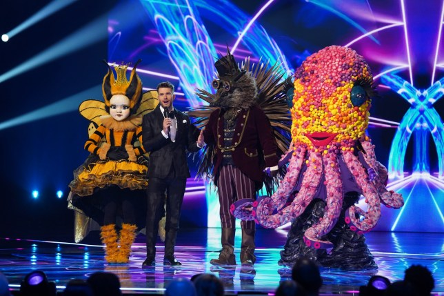 This image is strictly embargoed until 00.01 Friday 14th February 2020 From Bandicoot TV The Masked Singer: Ep8 on ITV Pictured: Queen Bee, Joel Dommett, Hedgehog and Octopus. This photograph is (C) Bandicoot TV and can only be reproduced for editorial purposes directly in connection with the programme or event mentioned above, or ITV plc. Once made available by ITV plc Picture Desk, this photograph can be reproduced once only up until the transmission [TX] date and no reproduction fee will be charged. Any subsequent usage may incur a fee. This photograph must not be manipulated [excluding basic cropping] in a manner which alters the visual appearance of the person photographed deemed detrimental or inappropriate by ITV plc Picture Desk. This photograph must not be syndicated to any other company, publication or website, or permanently archived, without the express written permission of ITV Picture Desk. Full Terms and conditions are available on the website www.itv.com/presscentre/itvpictures/terms For further information please contact: james.hilder@itv.com / 0207 157 3052