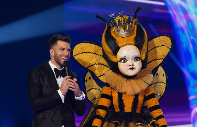 This image is strictly embargoed until 00.01 Friday 14th February 2020 From Bandicoot TV The Masked Singer: Ep8 on ITV Pictured: Joel Dommett and Queen Bee. This photograph is (C) Bandicoot TV and can only be reproduced for editorial purposes directly in connection with the programme or event mentioned above, or ITV plc. Once made available by ITV plc Picture Desk, this photograph can be reproduced once only up until the transmission [TX] date and no reproduction fee will be charged. Any subsequent usage may incur a fee. This photograph must not be manipulated [excluding basic cropping] in a manner which alters the visual appearance of the person photographed deemed detrimental or inappropriate by ITV plc Picture Desk. This photograph must not be syndicated to any other company, publication or website, or permanently archived, without the express written permission of ITV Picture Desk. Full Terms and conditions are available on the website www.itv.com/presscentre/itvpictures/terms For further information please contact: james.hilder@itv.com / 0207 157 3052