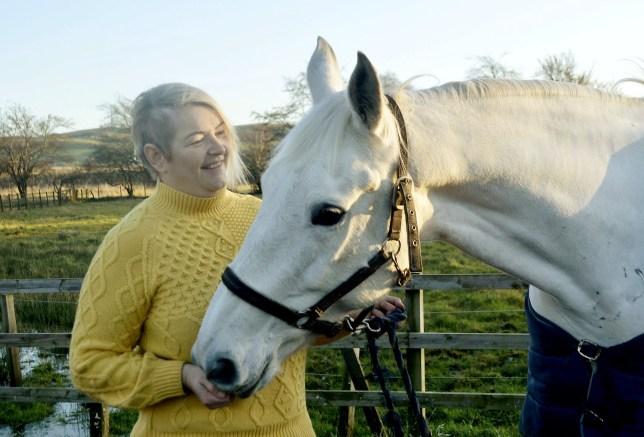 Kelly Ann Alexander, 43, with her horse Aliyana.