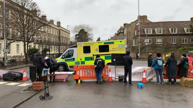 Extinction Rebellion protesters have blocked major routes into Cambridge this morning (February 16) as part of a week of protesting in the city. Cambridgeshire police are using emergency powers to close Fen Causeway and Trumpington Road in light of the protests. CAPTION An ambulance is refused through the blockade