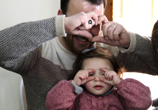 Syrian father Abdullah al-Mohammed gestures with his three-year-old daughter Salwa at their home in Sarmada, a town in Syria's last rebel pocket in the Idlib province, which Russian-backed Syrian regime forces are trying to crush on February 19, 2020. - In Syria's Idlib, there's no escaping the war, so Abdullah al-Mohammed says the only way he found to reassure his daughter Salwa was to turn the shelling into a game. A video in which she laughs every time an explosion goes off was widely shared on social media in recent days as a heartening but grim reminder of Idlib residents' daily lives (Photo by Abdulaziz KETAZ / AFP) (Photo by ABDULAZIZ KETAZ/AFP via Getty Images)