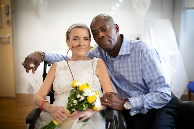 Pic By Juliette Harrison / Mercury Press (PICTURED: Chuk and Sarah Obanya at bucket list wedding Guys Hospital in London Pic Taken 30/02/2020) - A couple of 27 years finally tied the knot just days after the bride was diagnosed with terminal cancer and given two weeks to live - when she admitted not getting married was her biggest regret. Sarah Obanya, 46, wedded partner Chuk, 53, just five days after doctors diagnosed her with terminal ovarian cancer last month. The mum-of-one was first diagnosed with ovarian cancer in April 2019 but after a hysterectomy in October was given the all clear by doctors. However, in January the couple, from Lewisham, London, were devastated when medics told them the cancer had returned and spread through Sarahs body including into her lungs and bowel. And when Sarah revealed never getting hitched to Chuk was her biggest regret, friends scrambled to organise a bucket list wedding ceremony conducted as the bride lay in her hospital bed at Guys Hospital in London. - SEE MERCURY COPY