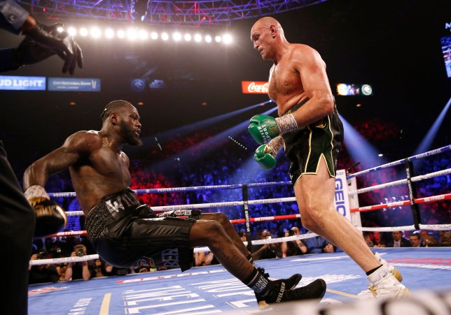 Boxing - Deontay Wilder v Tyson Fury - WBC Heavyweight Title - The Grand Garden Arena at MGM Grand, Las Vegas, United States - February 22, 2020 Tyson Fury knocks down Deontay Wilder during the fight REUTERS/Steve Marcus