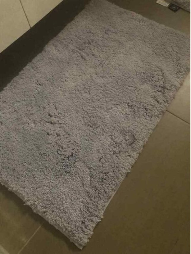 Aislinn James sparked debate online after asking whether her bathroom rug is grey or lilac. Aislinn James, from Australia, took to Facebook group ALDI Mums to reveal how she bought a light grey bathroom mat set from ALDI, before noticing in the evening that it had 'turned purple'. / Source: INTERNET
