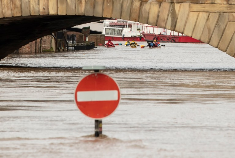 Canoeist near a road stop sign surrounded by flood water in York, after the River Ouse burst its banks, as a third consecutive weekend of stormy weather is bringing further flooding misery to already sodden communities. PA Photo. Picture date: Sunday February 23, 2020. See PA story WEATHER Storm. Photo credit should read: Danny Lawson/PA Wire
