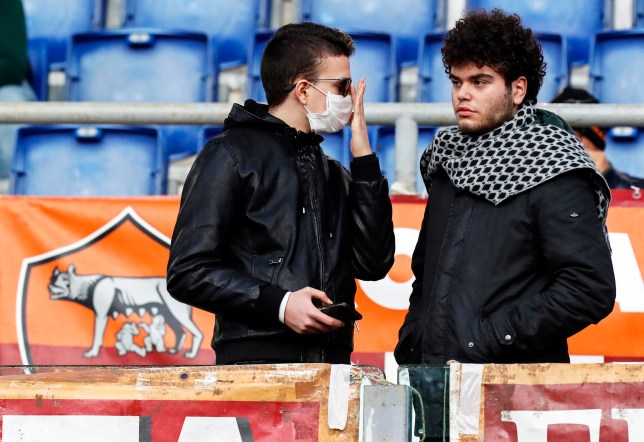 ARoma supporter wears a protective face mask due to the Coronavirus