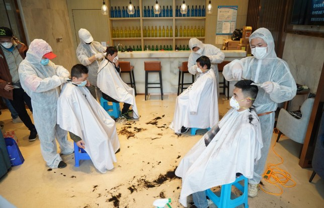 Mandatory Credit: Photo by CHINE NOUVELLE/SIPA/REX (10565980a) Volunteer barbers cut the hair for medical workers at the residence of medical team for Hankou Hospital in Wuhan, central China's Hubei Province. Five barbers provided free haircut service for members of medical team fighting against the novel coronavirus outbreak in Hankou Hospital as Monday marks Longtaitou Day. Coronavirus outbreak, China - 24 Feb 2020 The day of Longtaitou, which literally means 'dragon raises head', falls on the second day of the second lunar month. It is a traditionally busy day for hair salons as many Chinese believe that a new hairdo on that day will bring good luck, or one prior to that day will usher in bad luck. A voluntary team comprised of nearly 100 barbers have been providing free haircut service for medical workers in Wuhan. Nearly 4,000 medical workers have received haircut service in the past week.