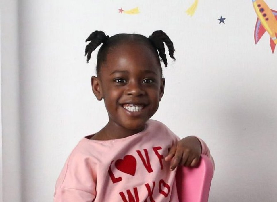 BECKENHAM, LONDON, FEBRUARY 25TH 2020. Six-year-old Faith Boyd is pictured at her home in South London, February 25th 2020. Faith was victim to racist bullying at her previous school and her mother Serlina Boyd has since written a book called 'Cocoa Girl' about her experiences and celebrating black children. Photo credit: Susannah Ireland