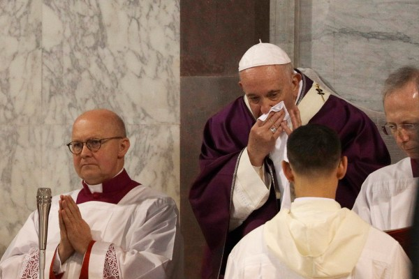 In this picture taken Wednesday, Feb. 26, 2020, Pope Francis wipes his nose during the Ash Wednesday Mass opening Lent, the forty-day period of abstinence and deprivation for Christians before Holy Week and Easter, inside the Basilica of Santa Sabina in Rome. Pope Francis is sick and skipped a planned Mass with Rome clergy across town on Thursday, Feb. 27, 2020, officials said. (AP Photo/Gregorio Borgia)