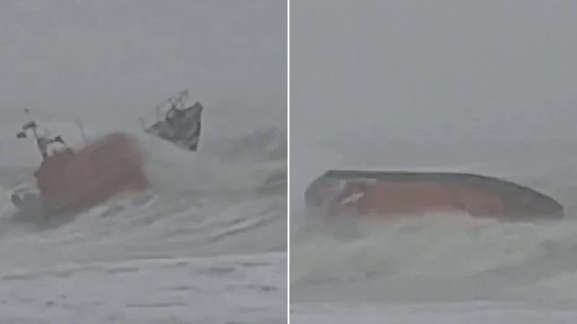 Volunteers at RNLI Hastings were knocked over by the choppy sea (Picture: @upshot11)