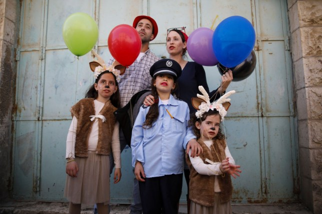 A family celebrating Purim in fancy dress