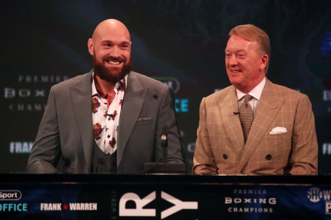 Tyson Fury of England and his promoter Frank Warren reacts during a press conference ahead of the match between Tyson Fury and Deontay Wilder