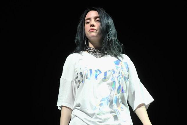 Billie Eilish performing on stage