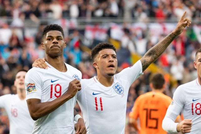 Marcus Rashford and Jadon Sancho celebrate a goal for England