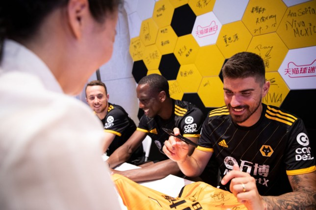 Wolves players including Ruben Neves sign autographs
