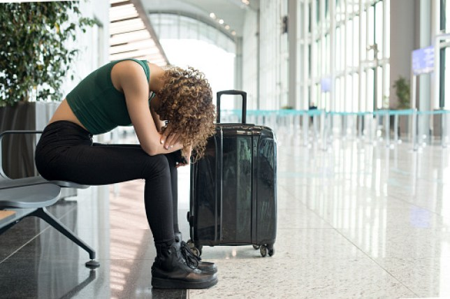 a woman Waiting for a flight in airport