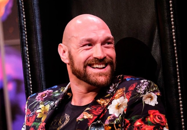Tyson Fury laughs during a press conference