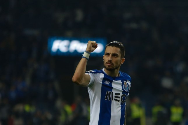 Alex Telles celebrates scoring for Porto
