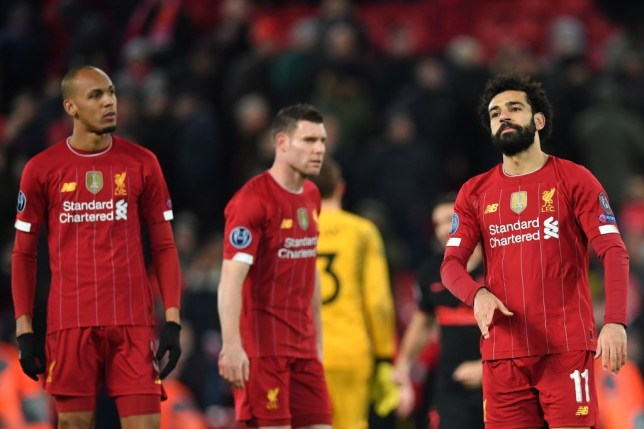 Liverpool players look on in dismay after losing a game