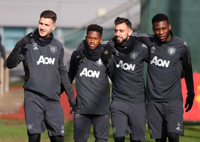 Bruno Fernandes is pictured in Manchester United training with Diogo Dalot and Fred