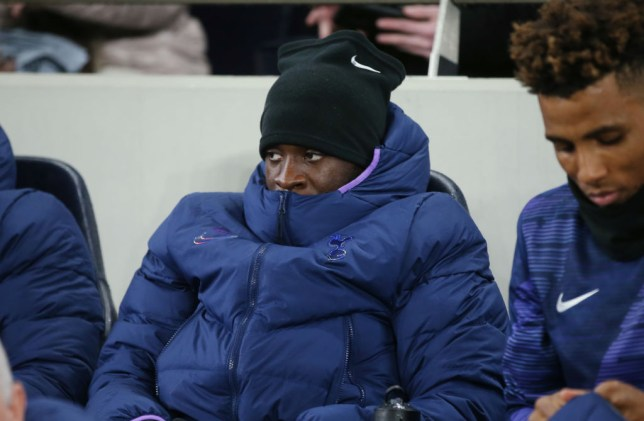Tanguy Ndombele sits on the bench during Tottenham's FA Cup clash with Norwich