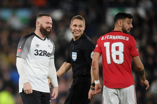 Wayne Rooney and Bruno Fernandes laugh in action for Derby and Manchester United