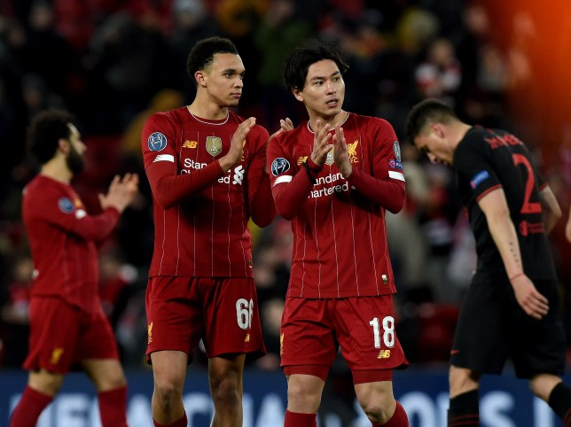 Trent Alexander-Arnold and Takumi Minamino after Liverpool's Champions League clash with Atletico Madrid