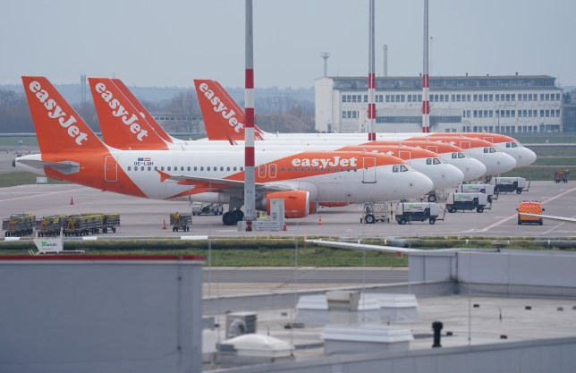 Passenger planes of discount airline EasyJet stand on the tarmac at Berlin-Schoenefeld Airport.