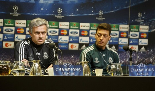 DORTMUND, GERMANY - APRIL 23:  Head coach Jose Mourinho (L) and Mesut Ozil of Real Madrid attend a press conference ahead of their UEFA Champions League Semi Final first leg match against Borussia Dortmund at Signal Iduna Park on April 23, 2013 in Dortmund, Germany.  (Photo by Angel Martinez/Real Madrid via Getty Images)