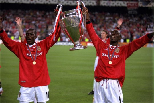 BARCELONA, SPAIN - MAY 26: Dwight Yorke and Andy Cole of Manchester United lift the European Cup after the UEFA Champions League Final between Bayern Munich v Manchester United at the Nou camp Stadium on 26 May, 1999 in Barcelona, Spain. Bayern Munich 1 Manchester United 2. (Photo by Matthew Peters/Manchester United via Getty Images)