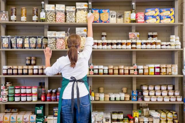 Clerk working in grocery store.