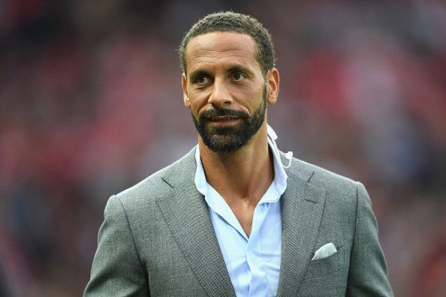 Manchester United icon Rio Ferdinand looks on during the Wayne Rooney Testimonial match between Manchester United and Everton at Old Trafford