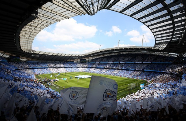 Coronavirus UK: Manchester City sign over the Eithad ...