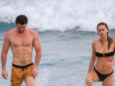 Liam Hemsworth and Gabriella Brooks start the day off right with a morning dip in Byron Bay