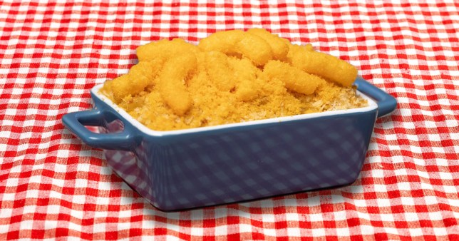 Wotsits mac n cheese in pot on checkered red and white tablecloth