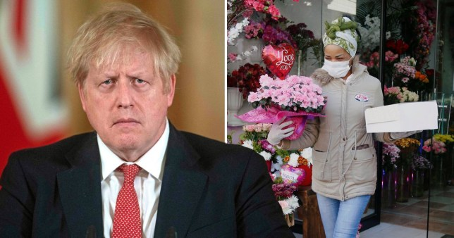 Prime Minister Boris Johnson and person wearing protective face masks carrying bouquet of flowers