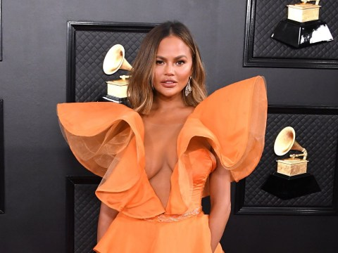 Chrissy Teigen reveals boob job at 20 – but she'd very much like them out now, please