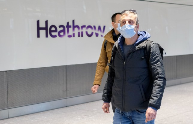 People arriving at Heathrow airport terminal 5 wearing facemasks due to the outbreak of coronavirus