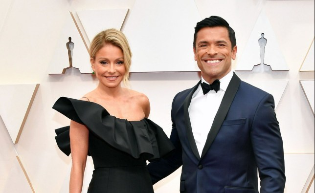 Kelly Ripa and Mark Consuelos attend the 92nd Annual Academy Awards