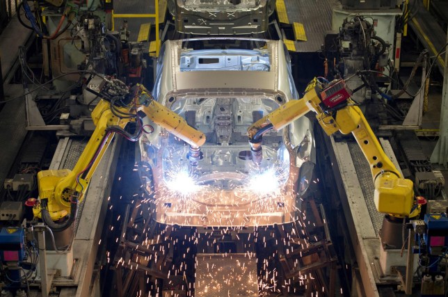 """(FILES) In this file photo taken on November 12, 2014 Robots weld vehicle panels in the Body Shop at the Nissan Sunderland Plant in North East England. - Britain's economy saw zero growth in the final quarter of last year as manufacturing shrank heading into the country's general election that unlocked Brexit, official data showed on February 11, 2020. """"There was no growth in the last quarter of 2019 as increases in the services and construction sectors were offset by another poor showing from manufacturing, particularly the motor industry,"""" said Rob Kent-Smith at the Office for National Statistics (ONS). (Photo by Oli SCARFF / AFP) (Photo by OLI SCARFF/AFP via Getty Images)"""