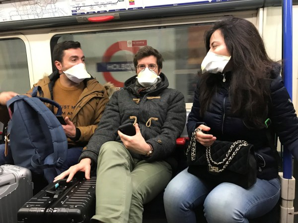 People wearing face masks on the London Underground, as the first case of coronavirus has been confirmed in Wales and two more were identified in England - bringing the total number in the UK to 19. PA Photo. Picture date: Friday February 28, 2020. The Japanese Ministry of Health has confirmed the first Briton to die from coronavirus after a Biritsh tourist on board the Diamond Princess cruise ship has died. See PA story HEALTH Coronavirus. Photo credit should read: Kirsty O'Connor/PA Wire