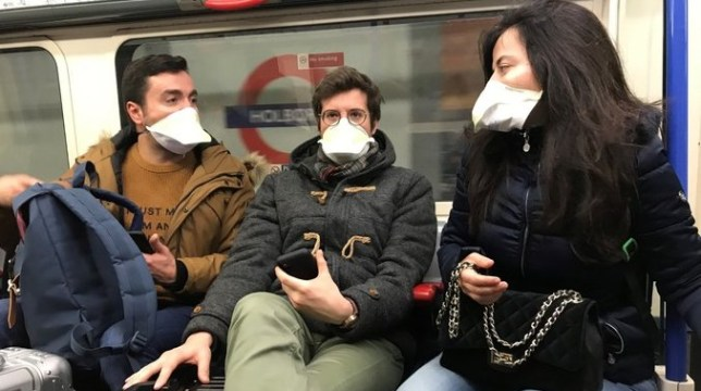 passengers on the london underground wearing coronavirus masks