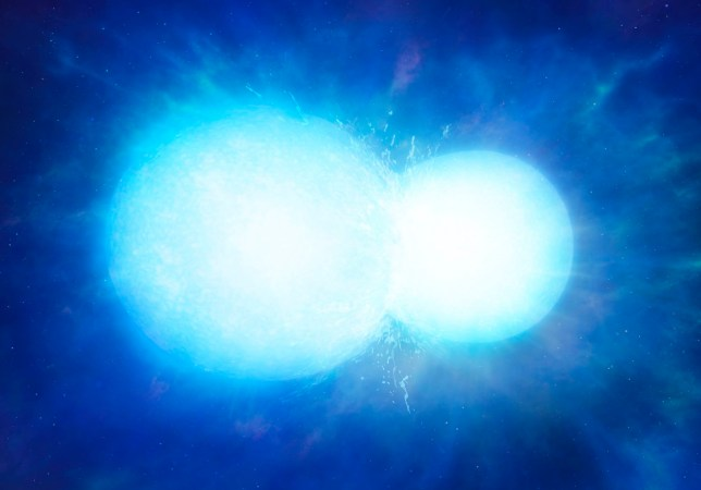 """Undated handout image issued by the University of Warwick of an artist's impression of two white dwarfs in the process of merging. PA Photo. Issue date: Monday March 2, 2020. An ultra-massive white dwarf star with """"unusually high"""" levels of carbon in its atmosphere has been discovered by astronomers. See PA story SCIENCE Star. Photo credit should read: University of Warwick/Mark Garlick/PA Wire NOTE TO EDITORS: This handout photo may only be used in for editorial reporting purposes for the contemporaneous illustration of events, things or the people in the image or facts mentioned in the caption. Reuse of the picture may require further permission from the copyright holder."""