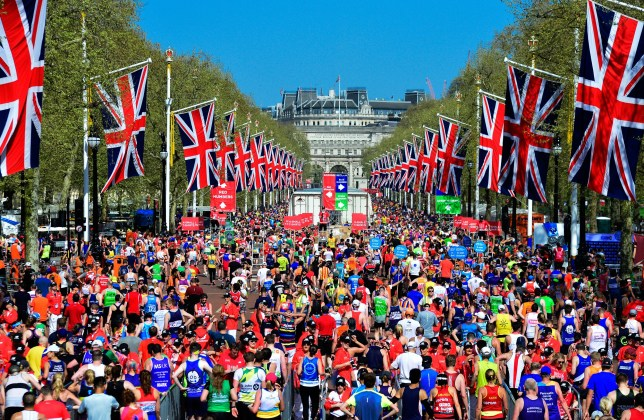 LONDON, ENGLAND - APRIL 22: Runners finish on The Mall during the The Virgin London Marathon on April 22, 2018 in London, England. (Photo by Leo Mason/Popperfoto via Getty Images)