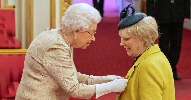 Queen Elizabeth II wears gloves as she awards the CBE (Commander of the Order of the British Empire) to Miss Anne Craig, known professionally as actress Wendy Craig, during an investiture ceremony at Buckingham Palace in London. PA Photo. Picture date: Tuesday March 3, 2020. Buckingham Palace declined to confirm whether the Queen was taking the precaution because of the coronavirus outbreak. See PA story HEALTH Coronavirus. Photo credit should read: Dominic Lipinski/PA Wire