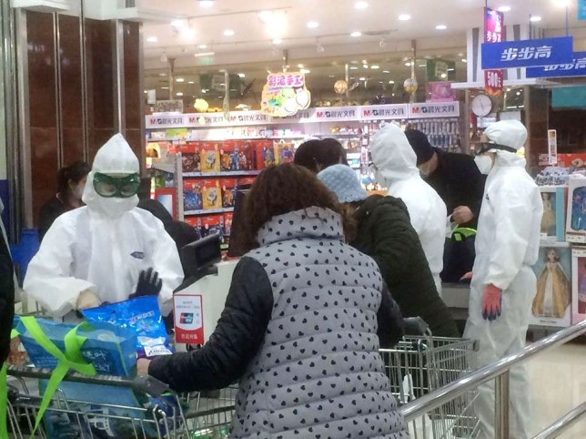 People Wearing Surgical Masks in China Pictured: People wearing hazmat suits at a supermarket Ref: SPL5153985 040320 NON-EXCLUSIVE Picture by: SplashNews.com Splash News and Pictures Los Angeles: 310-821-2666 New York: 212-619-2666 London: +44 (0)20 7644 7656 Berlin: +49 175 3764 166 photodesk@splashnews.com World Rights,